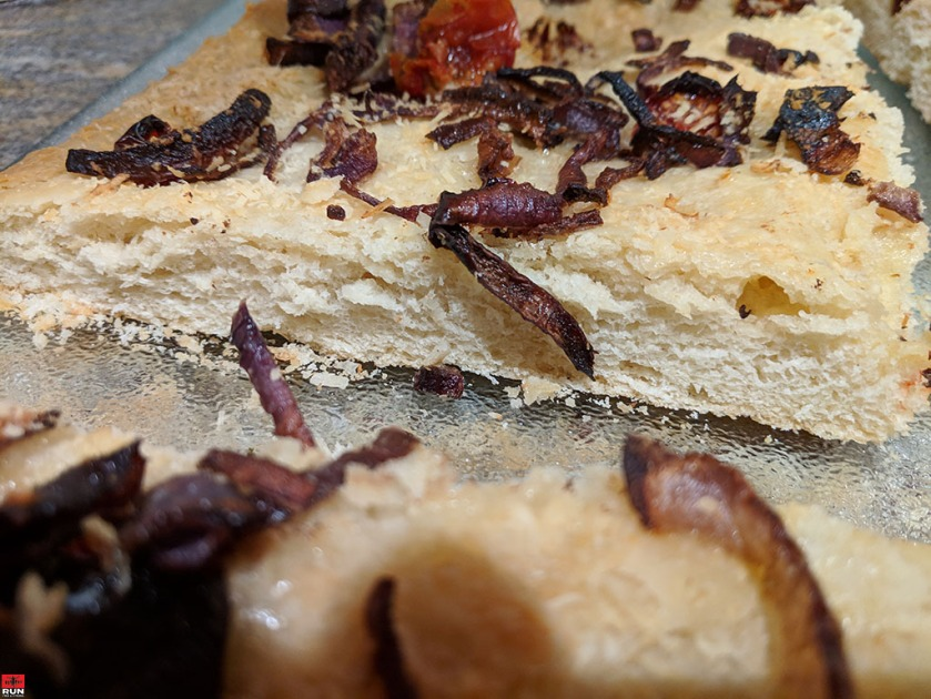 Baked Focaccia Bread showing crust and airy, chewy center
