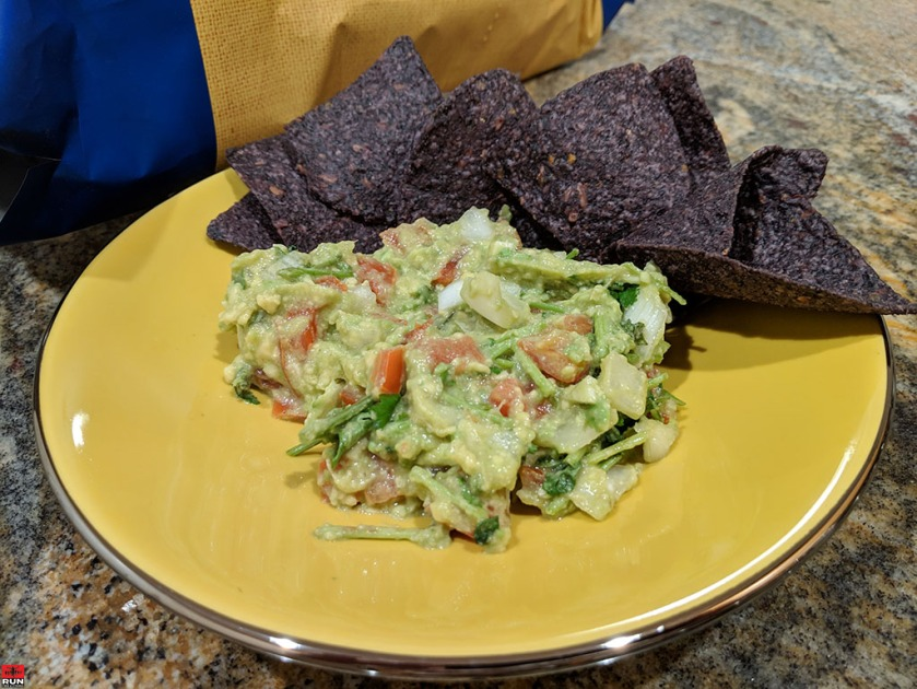 Guacamole dip served with organic Blue Corn chips