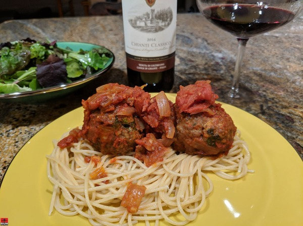 Italian Meatballs on Spaghetti Garnished with Tomato Sauce