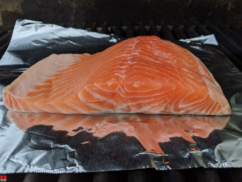 Cooking fresh salmon on barbecue for Vietnamese Summer Rolls